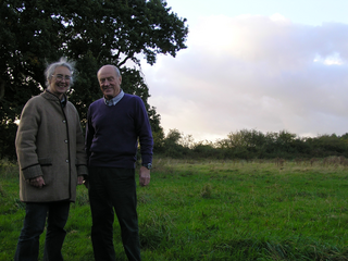 Councillors Lucy Care and Mike Carr in Millennium Wood where improvements for people and wildlife are planned