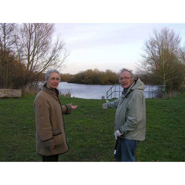 Cllrs Lucy Care and Eric Ashburner, indicating the area where car parking will be allowed for anglers by Heatherton Pond