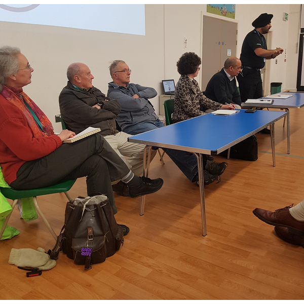 Police Inspector Dol and local Liberal Democrat Councillors address public meeting about burglaries in and around Littleover