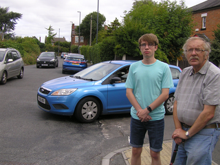 Cllr Eric Ashburner and Tom Bull inspecting problem parking in Littleover