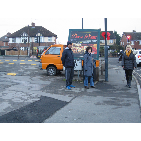 Cllrs Joe Naitta and Ruth Skelton watch Danielle Lind using the pavement around the parking area