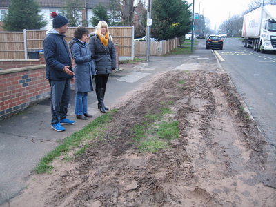 Cllrs Joe Naitta and Ruth Skelton with Danielle Lind witness a sea of mud