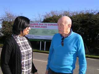 Cllr Mike Carr and Preetinder Butter at the site of the new hoarding