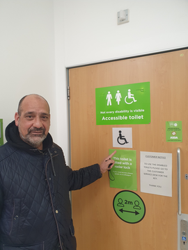 Cllr Joe Naitta With A New Disabled Toilet Sign