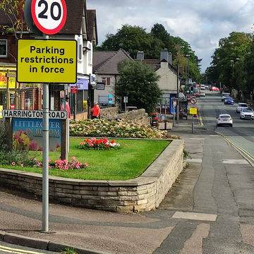 View down Burton Road showing Southview shopping area in Littleover and pavement